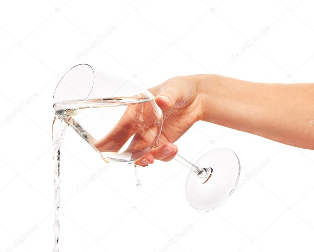Water Pouring From Full Wine Glass In Woman S Hand Stock