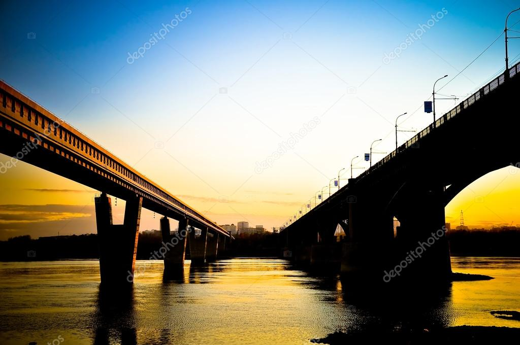 Bridge across the river at sunset