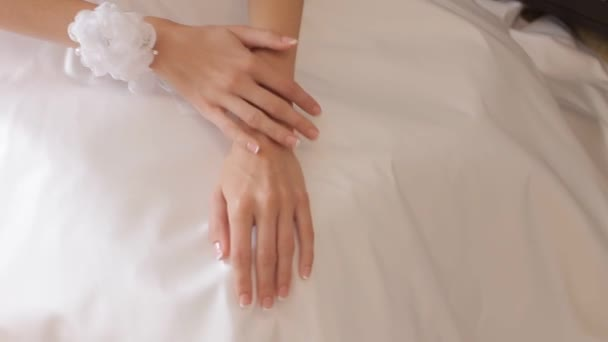 Beautiful brides hands in wedding dress
