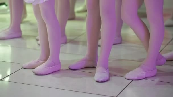 feet of young girls and boys dancing slippers