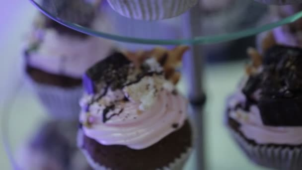 delicious cupcakes with chocolate on a stand