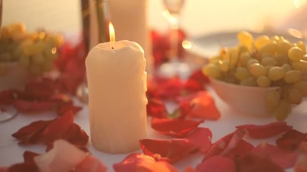 Romantic night. Rose and candles on table.