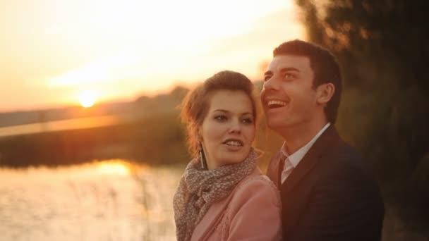 Honeymoon couple romantic in love at beach sunset.