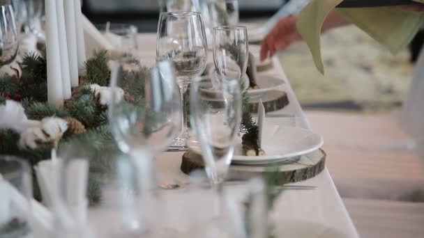 The waiter serves rustic wedding table