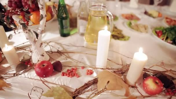gently lit white candles on the table
