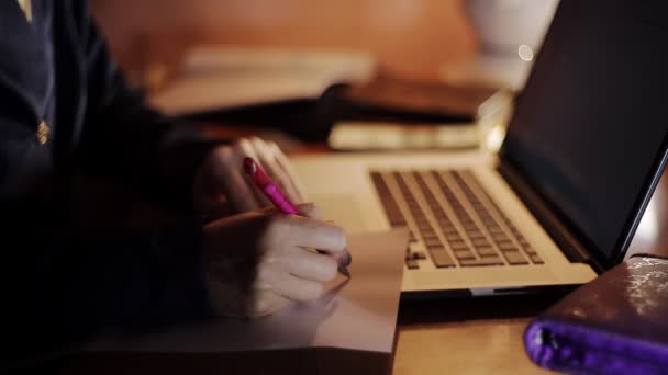 business woman working at a laptop in the evening