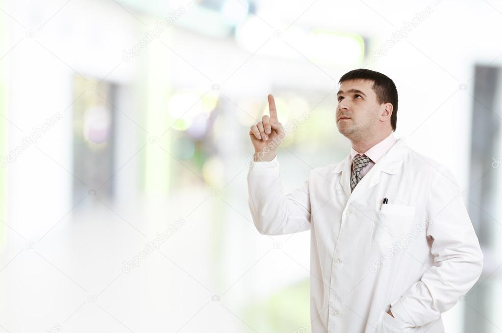 The doctor points finger up - Stock Image