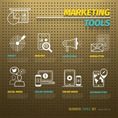 Marketing Tools on Brown Pegboard