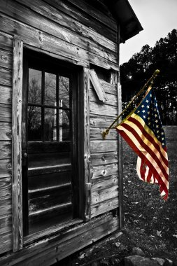 USA Flag Hangs From an Old Cabin Color Splash