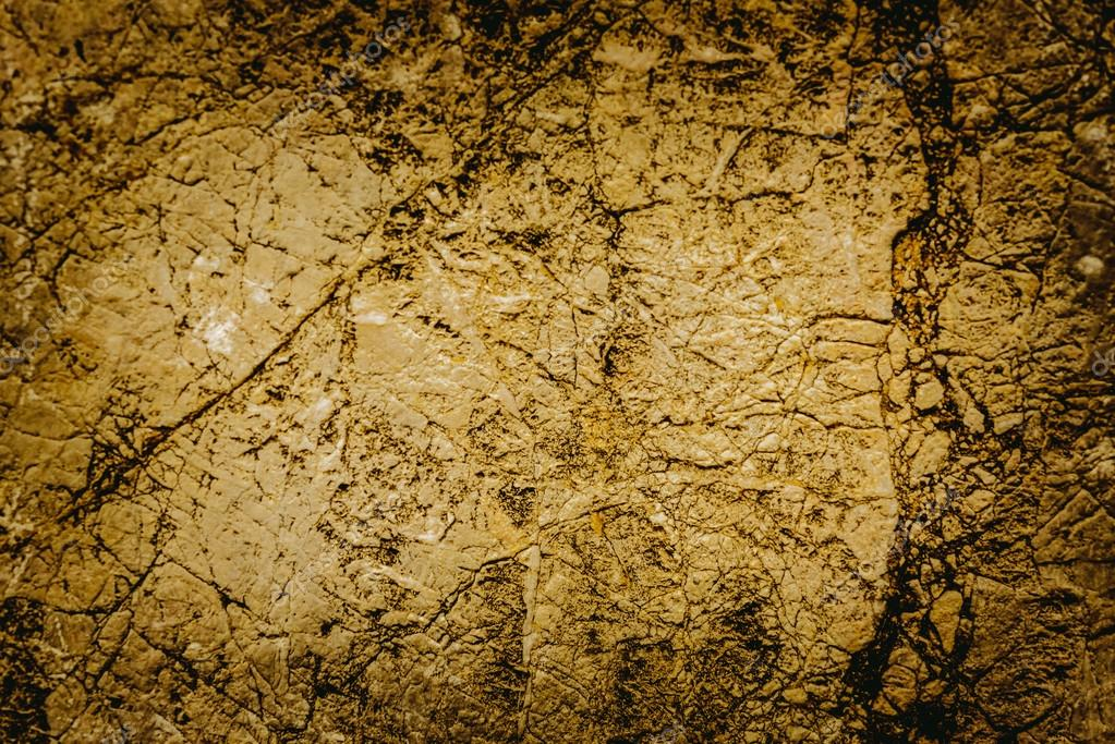Close up texture of grunge cracked old stone wall.For art textur ...