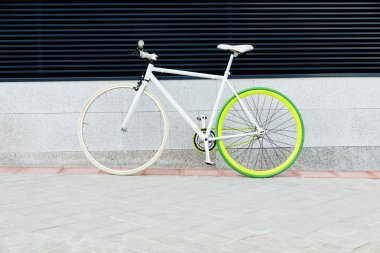 City bicycle fixed gear on wall.
