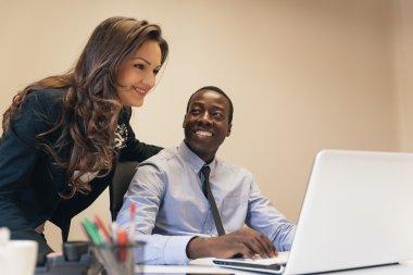 Young Multi-Ethnic Couple Working.