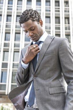 african american business man adjusting his neck tie
