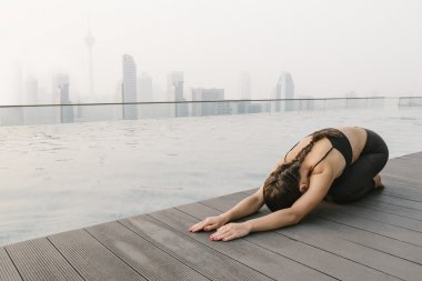 Woman Doing Yoga in a Big City