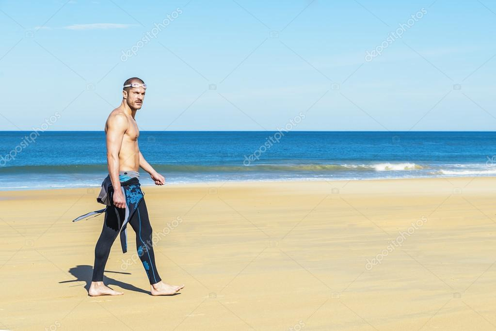 Handsome Swimmer ready to start swimming