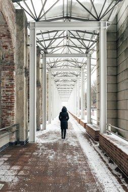Loneliness woman walking on bridge.
