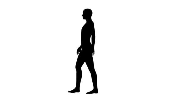 Sziluettjét sétáló férfi