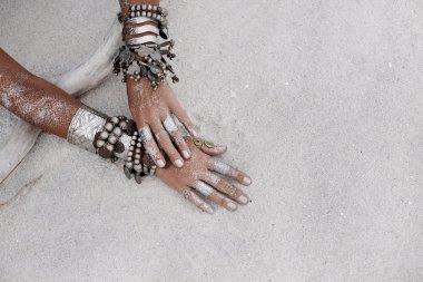close up of beautiful tribal woman. Hands of ethnic dancer.