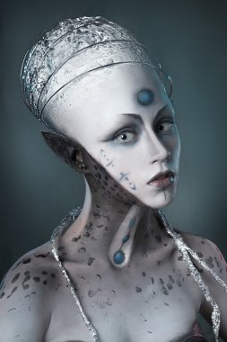 Portrait of a girl with makeup Alien