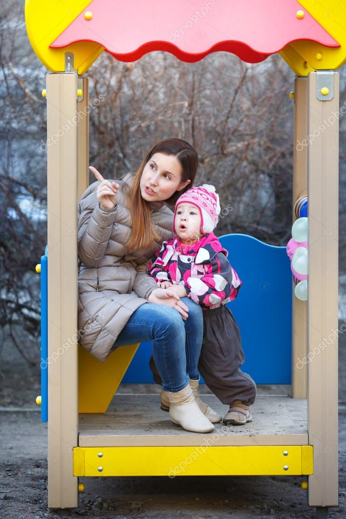 Mother and daughter in the park in the gazebo