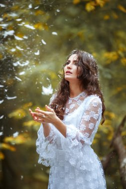 beautiful girl in a mystical forest