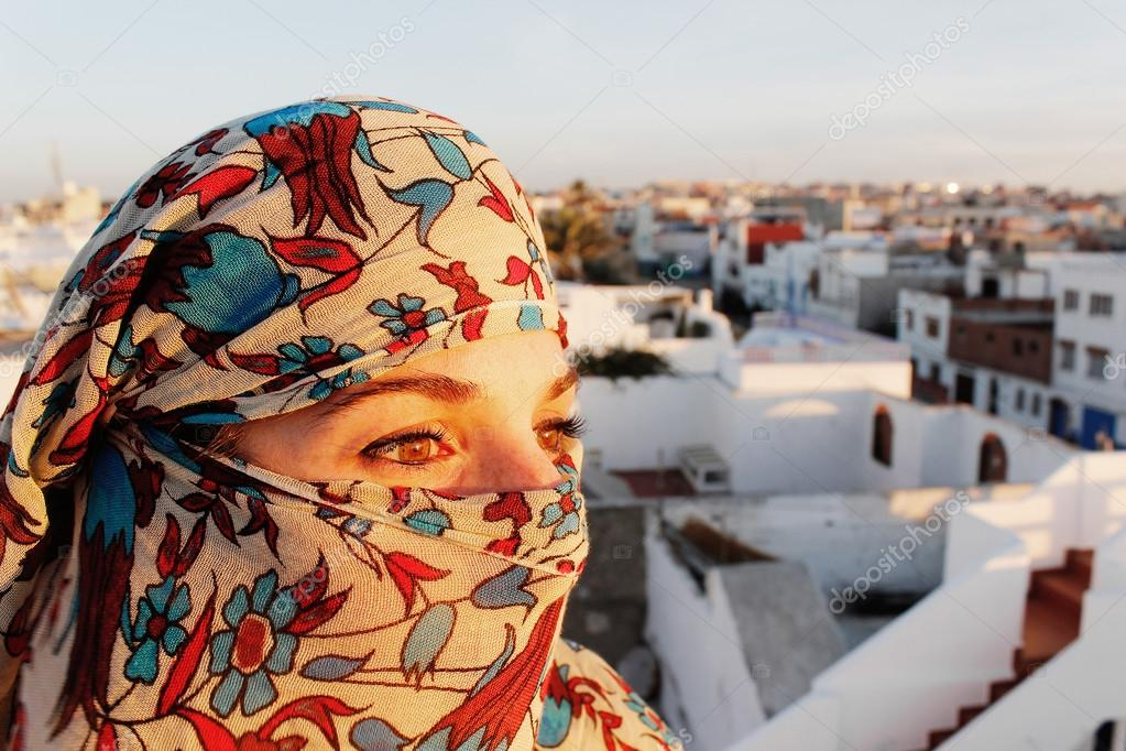 Young arab woman in hijab with sexy eyes. Rooftop terrace view