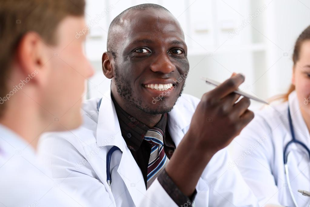 Portrait of young handsome black male doctor — Stock Photo