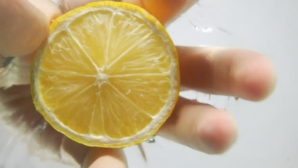 Pull half lemon from water