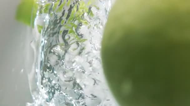 Two apple halfs fall down into water
