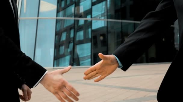 Two business partner shake hands
