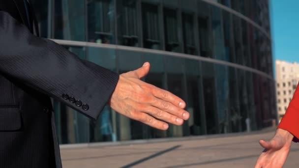 Businesspeoeple handshake outdoor