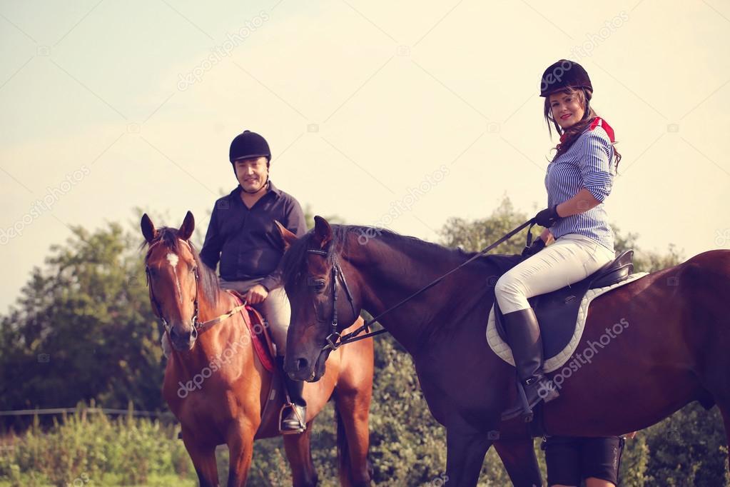 Couple riding their horses