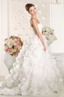 Gorgeous bride wearing a superb  white wedding dress