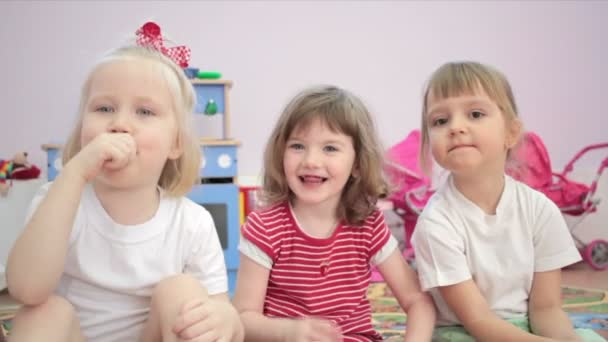 Small girls making a funny face in the kindergarten