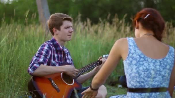 Guy Playing Guitar For His Girlfriend