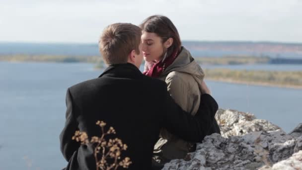 Couple in the mountains enjoying life and kissing