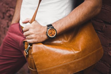 fashion man, with casual leather bag and watch