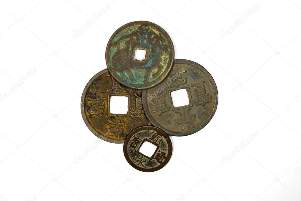 Ancient Chinese Bronze Coins On White Background Stock Photo