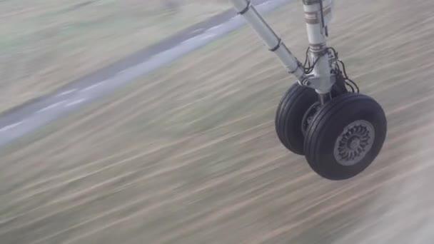 Airplane wheels touching ground in rains.