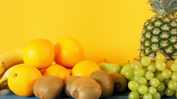 Beautiful fruits on a yellow wall background