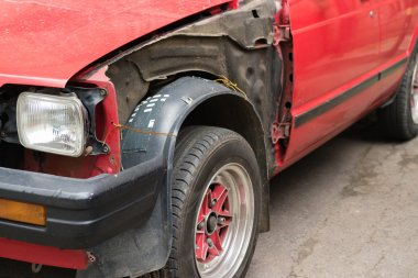 Damaged red car without body parts