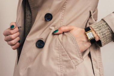 Woman put her hand in coat pocket