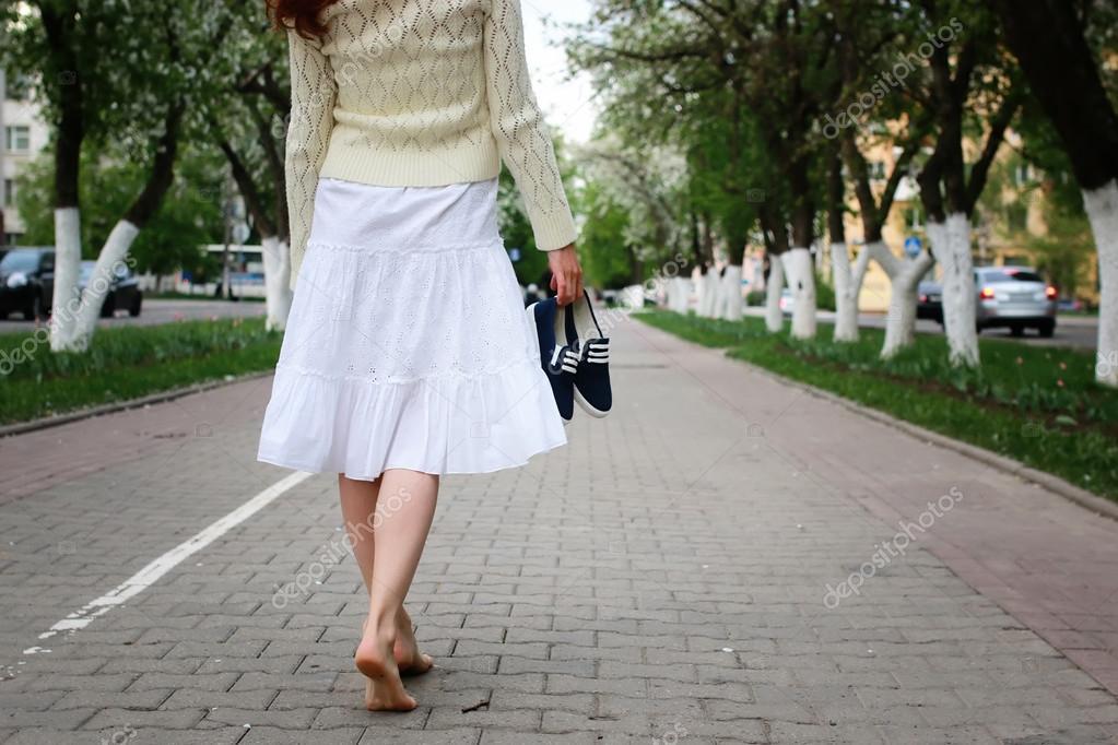 barefoot girl on street