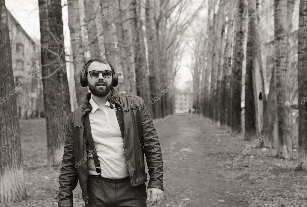 monochrome beard man listen music in park