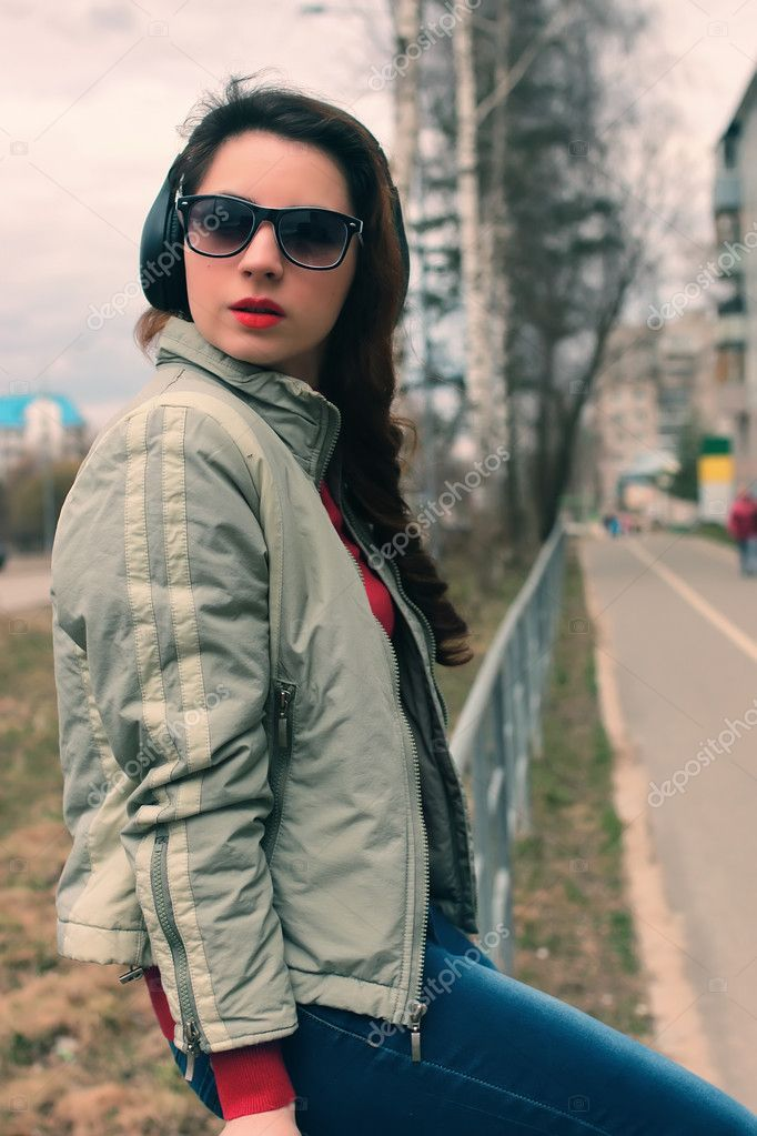 girl in park with headphone