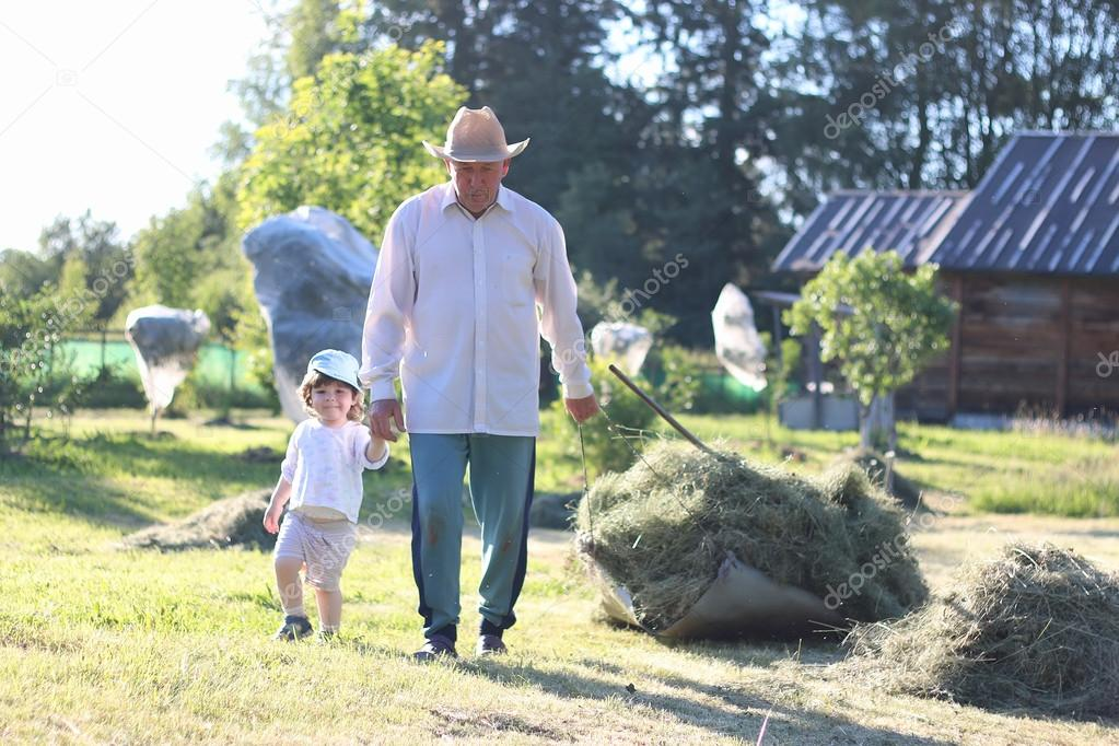 child and grandfather harvested hay