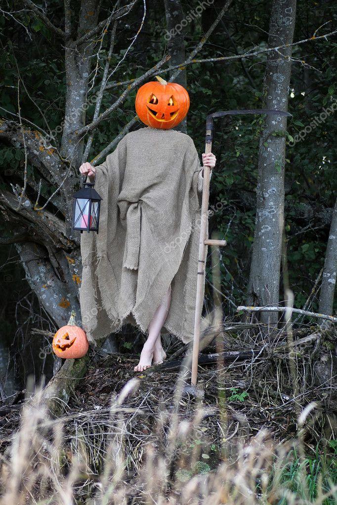 Horror Pumpkin With A Scythe Stock Photo
