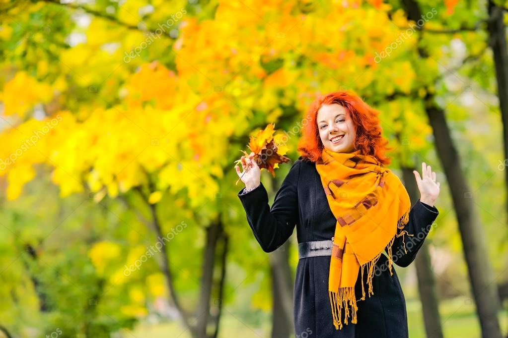 Portrait of red-haired girls outdoors. Casting in his hand. The