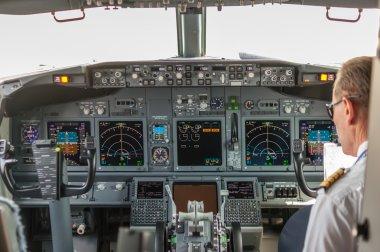 Pilot in the cockpit of a passenger plane