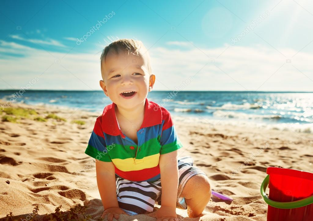 little boy smiling at the beach